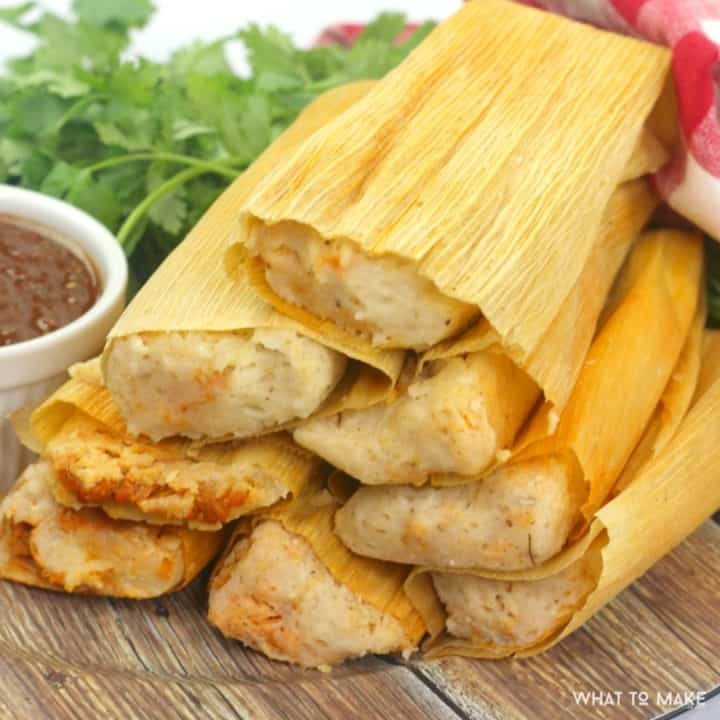 Square image of pork tamales that have been cooked in an instant pot.