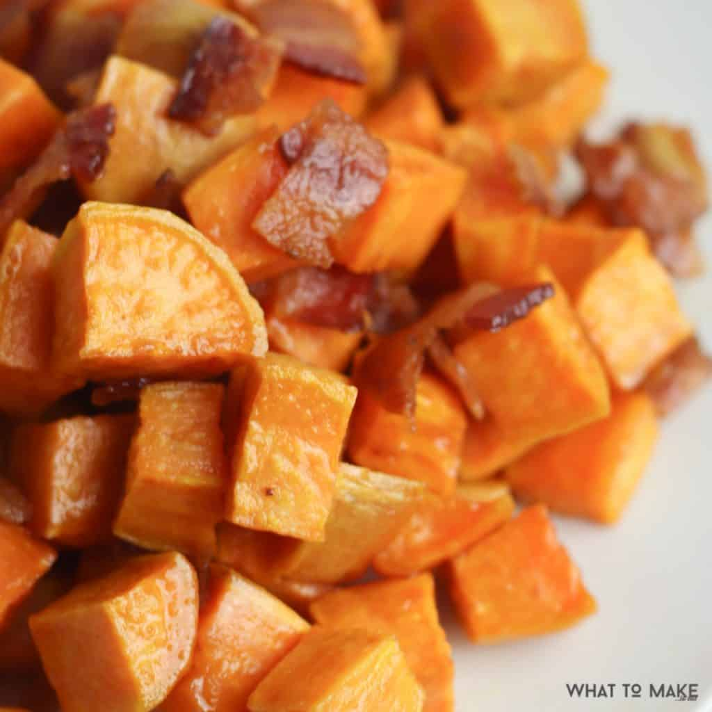 close up picture of roasted sweet potatoe chunks with bacon