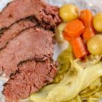 Close up image of a plate of corned beef and cabbage that has been cooked in a pressure cooker