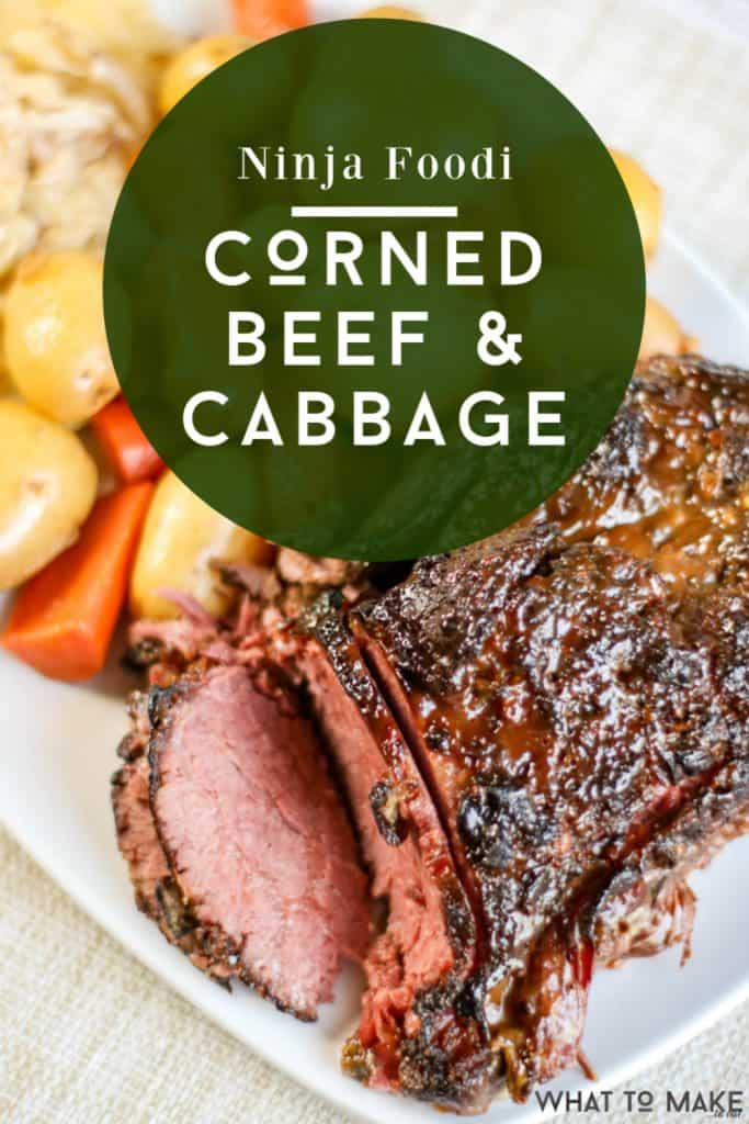 """Platter of cooked corned beef and cabbage. Text says """"Ninja Foodi Corned Beef & Cabbage"""""""