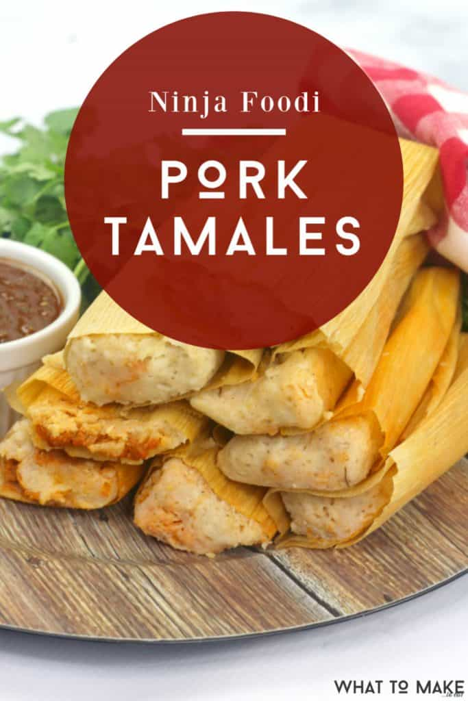 "Image of several pork tamales stacked on a wood plate. Text on image says ""Ninja Foodi Pork Tamales"""