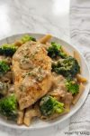 Plate of chicken and broccoli in garlic sauce.
