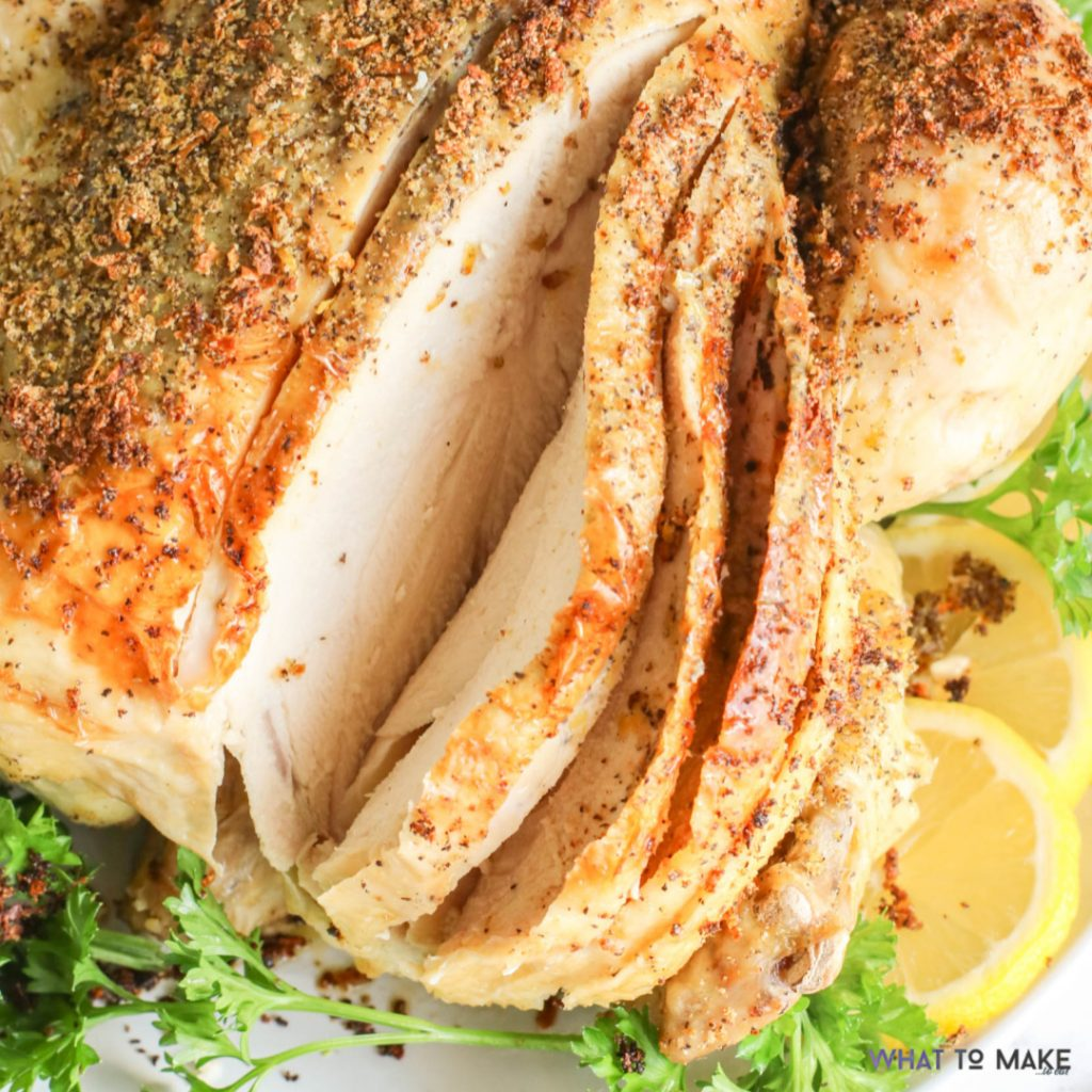 Image of a cooked lemon pepper chicken sitting on a platter.