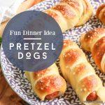 """pretzel hot dogs on a plate. Text reads """"Fun dinner idea - pretzel dogs"""""""