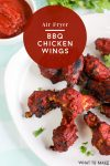 """Plate of air fryer bbq chicken wings. Text reads """"air fryer bbq chicken wings.""""."""""""