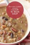 """Bowl of Cajun 15 bean soup cooked in a pressure cooker. Text reads """"Pressure cooker Cajun 15 bean soup"""""""