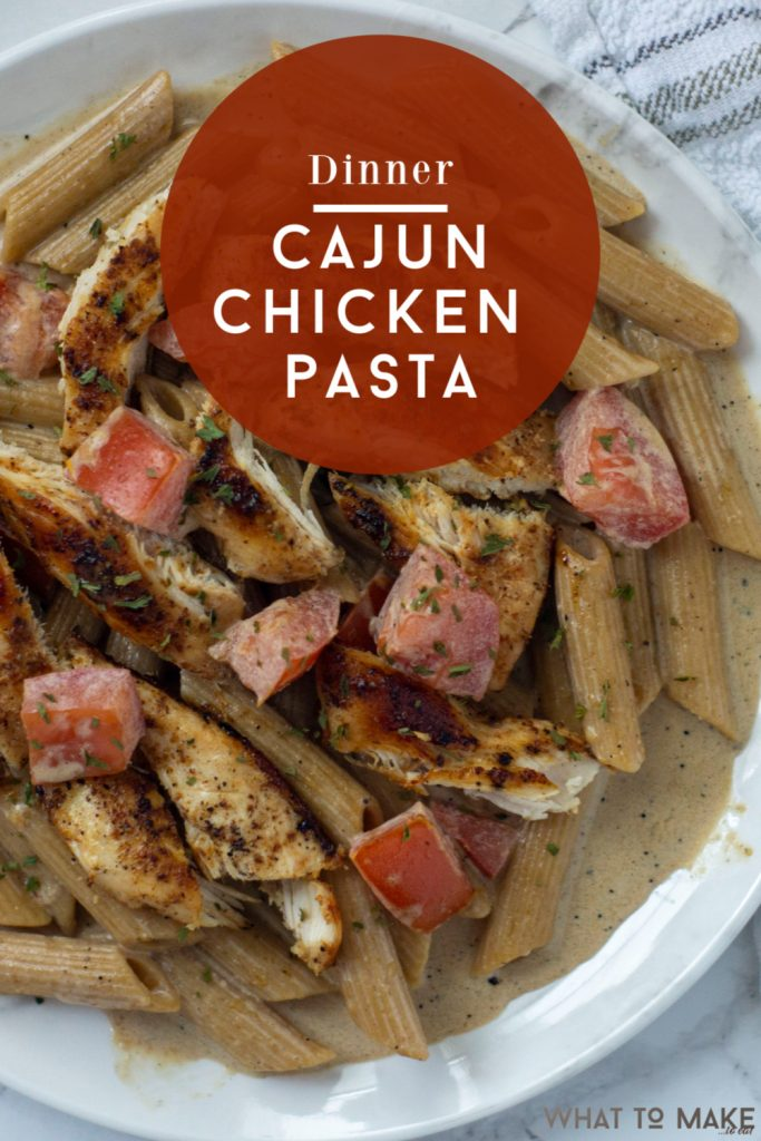 """Image is of an easy cajun chicken pasta penne dish. Text reads """"dinner Cajun chicken pasta"""""""